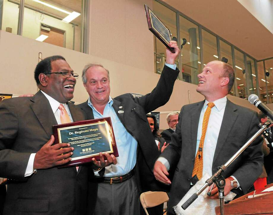 (Mara Lavitt — New Haven Register) October 6, 2013 New HavenEast Rock Community Magnet School was dedicated today. The school is the 37th to be built in the New Haven School Construction Program, which began in 1995. Retired New Haven School From left: Superintendent Reginald Mayo and New Haven Mayor John DeStefano, Jr. were honored by Superintendent Garth Harries for their leadership on the school construction program. Photo: Journal Register Co. / Mara Lavitt