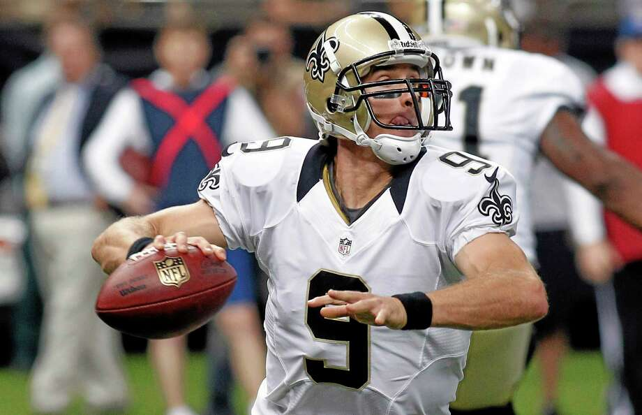New Orleans Saints quarterback Drew Brees (9) scrambles during the first half of an NFL preseason football game against the Kansas City Chiefs at the Mercedes-Benz Superdome in New Orleans, Friday, Aug. 9, 2013. (AP Photo/Jonathan Bachman) Photo: AP / FR170615 AP