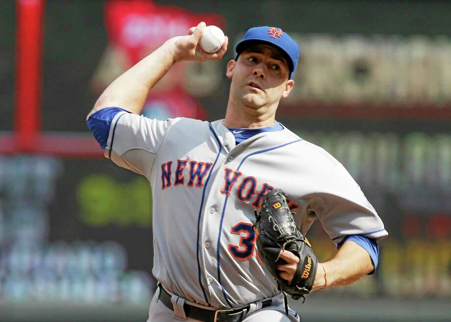New York Mets pitcher Dillon Gee throws against the Minnesota Twins in the eighth inning of a baseball game, Monday, Aug. 19, 2013 in Minneapolis where he picked up his ninth win as the Mets beat the Twins 6-1. (AP Photo/Jim Mone) Photo: AP / AP
