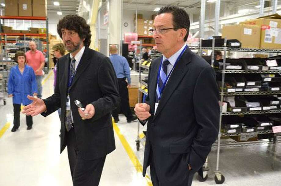 Governor Dannel P. Malloy walks with President Richard Razza of Altek Electronics at their facility in Torringon in December as the tech manufacturer celebrated its 40th year. John Berry/Register Citizen.