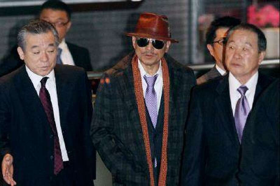 Kenichi Shinoda, the boss of Japan's largest 'yakuza' gang, the Yamaguchi-gumi, walks at Tokyo's Shinagawa station to return to his his home in Kobe, western Japan on April 9, 2011 after he was released from a Tokyo prison after serving time since 2005.