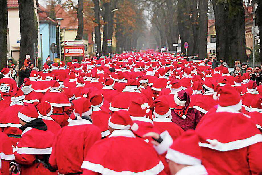 Santa Clauses running to town. Photo: Journal Register Co.