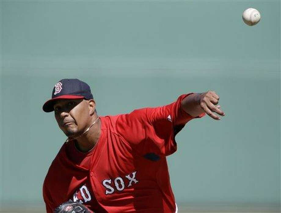 Boston Red Sox starting pitcher Felix Doubront throws a pitch in the first inning of an exhibition spring training baseball game against the Tampa Bay Rays, Monday, March 4, 2013, in Fort Myers, Fla. (AP Photo/David Goldman) Photo: ASSOCIATED PRESS / AP2013