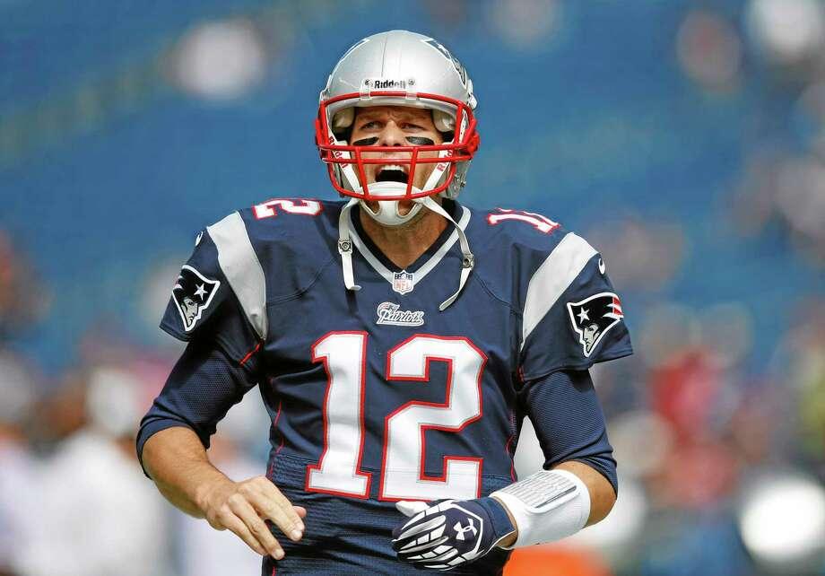 Quarterback Tom Brady will lead New England into Cincinnati today as the Patriots try to start the season 5-0. Photo: Elise Amendola — The Associated Press   / AP