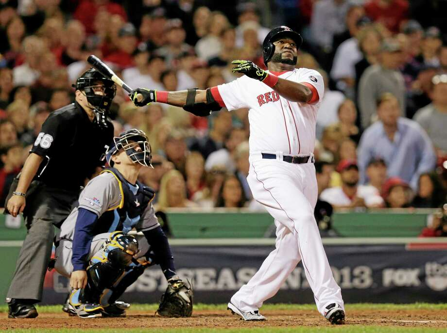 Red Sox designated hitter David Ortiz, and Rays catcher Jose Molina, watch Ortiz's second home run of the game off Tampa Bay starter David Price on Saturday in the eighth inning of Game 2 of the American League division series at Fenway Park in Boston. Photo: Charles Krupa — The Associated Press   / AP