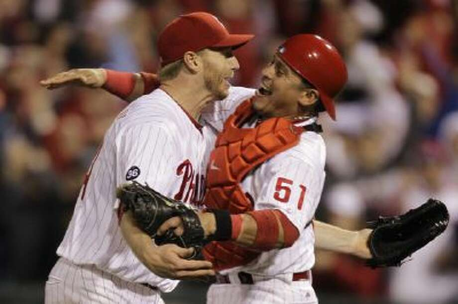 Roy Halladay and Carlos Ruiz celebrate after Halladay's no-hitter in Game 1 of the 2010 National League Division Series.