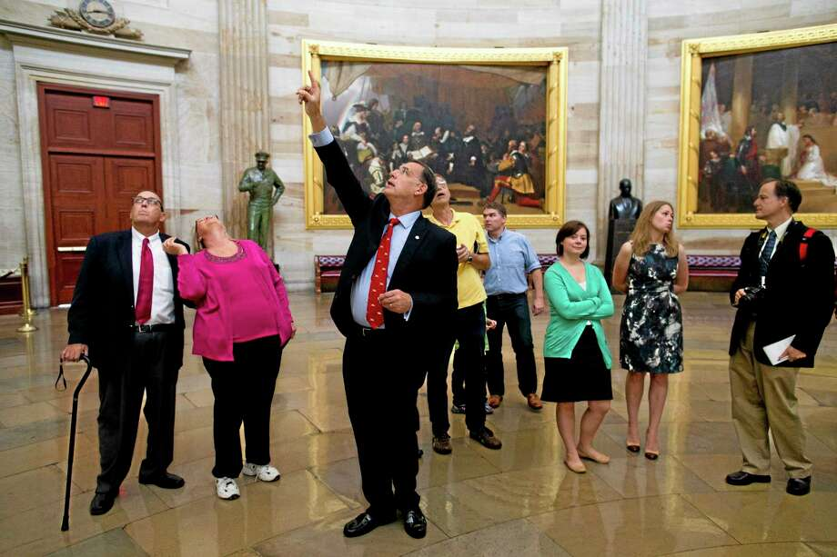 Sen. John Boozman, R-Ark., leads a tour in the Rotunda on Capitol Hill in Washington on Thursday, Oct. 3, 2013. Congressional staffers and interns usually lead constituent tours, but due to the federal government shutdown members of Congress have begun to lead tour groups from their home states. (AP Photo/ Evan Vucci) Photo: AP / AP