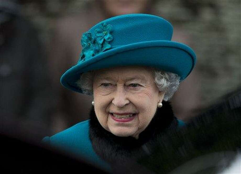 A Tuesday, Dec. 25, 2012 photo from files showing Britain's Queen Elizabeth II as she walks to get in her car after attending the British royal family's traditional Christmas Day church service in Sandringham, England.  Queen Elizabeth has been taken to the King Edward VII hospital in central London suffering from gastroenteritis, Sunday, March 3, 2013. A palace spokesman said she was expected to stay in hospital for two days and all engagements for this week will be either postponed or cancelled. (AP Photo/Matt Dunham, File) Photo: AP / AP
