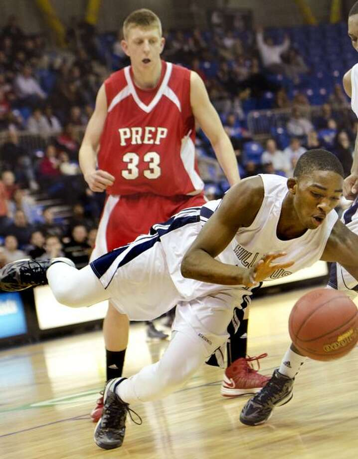 Raiquan Clar, of Hillhouse goes for a loose ball during the SCC championship game against Fairfield Prep. In back is Prep's Tim Butala.  Melanie Stengel/Register