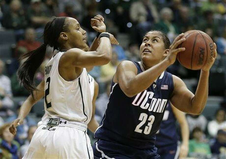 Connecticut forward Kaleena Mosqueda-Lewis (23) shoots over South Florida guard Andrell Smith (12) during the second half of an NCAA women's college basketball game Saturday, March 2, 2013, in Tampa, Fla. Connecticut won the game 85-51. (AP Photo/Chris O'Meara) Photo: AP / AP