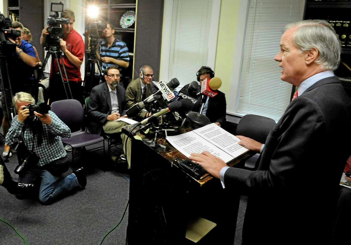 Republican Tom Foley, right, speaks at a news conference to announce a committee to explore his prospects for the 2014 Connecticut governor's race in Bridgeport, Conn., Tuesday, Sept. 10, 2013. Foley said Tuesday that he is weighing another run for Connecticut governor, attacking the record of the Democrat who defeated him in 2010. (AP Photo/Jessica Hill)