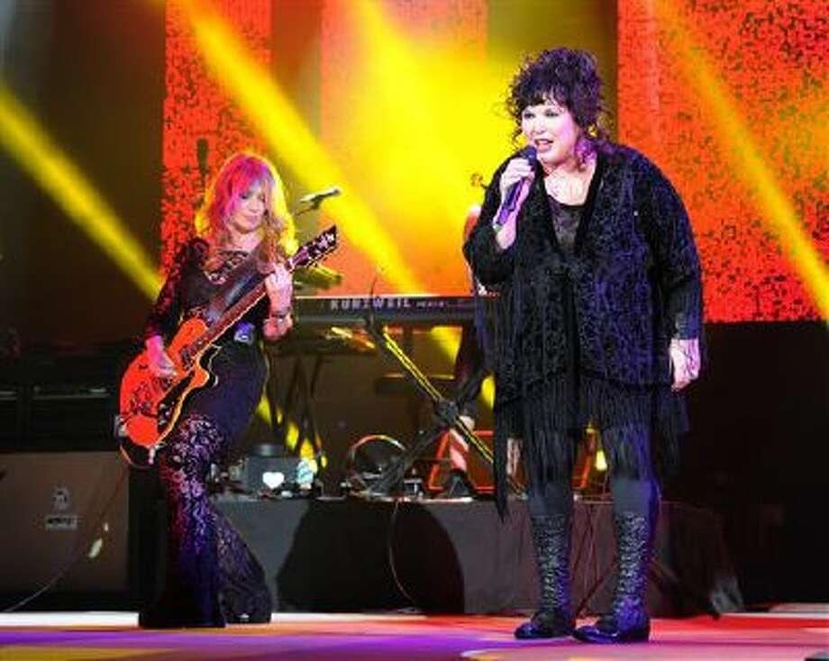 This June 17, 2013 file photo shows Nancy Wilson, left, and Ann Wilson of Heart performing on opening night of the Heartbreaker Tour at the Cruzan Amphitheater in West Palm Beach, Fla. The group Heart is the latest act to cancel an appearance at SeaWorld Orlando's Bands, Brew & Barbecue music series in February. Photo: Jeff Daly/Invision/AP / Invision
