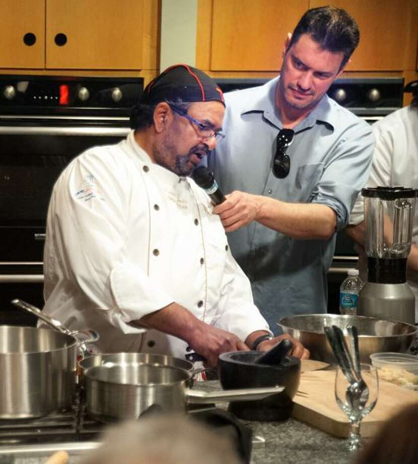 VM Williams/Register photo: Mike Devlin interviews Chef Prasad Chirnomula during the Iron Chef competition at HADCO in Wallingford recently.
