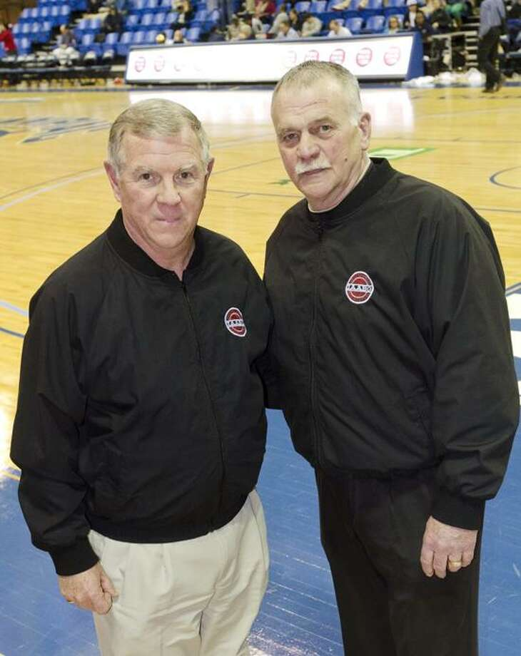 Steve Kirck, left, and Pat Paulson have decided to retire after a combined 71 seasons as referees. (Register staff photo)