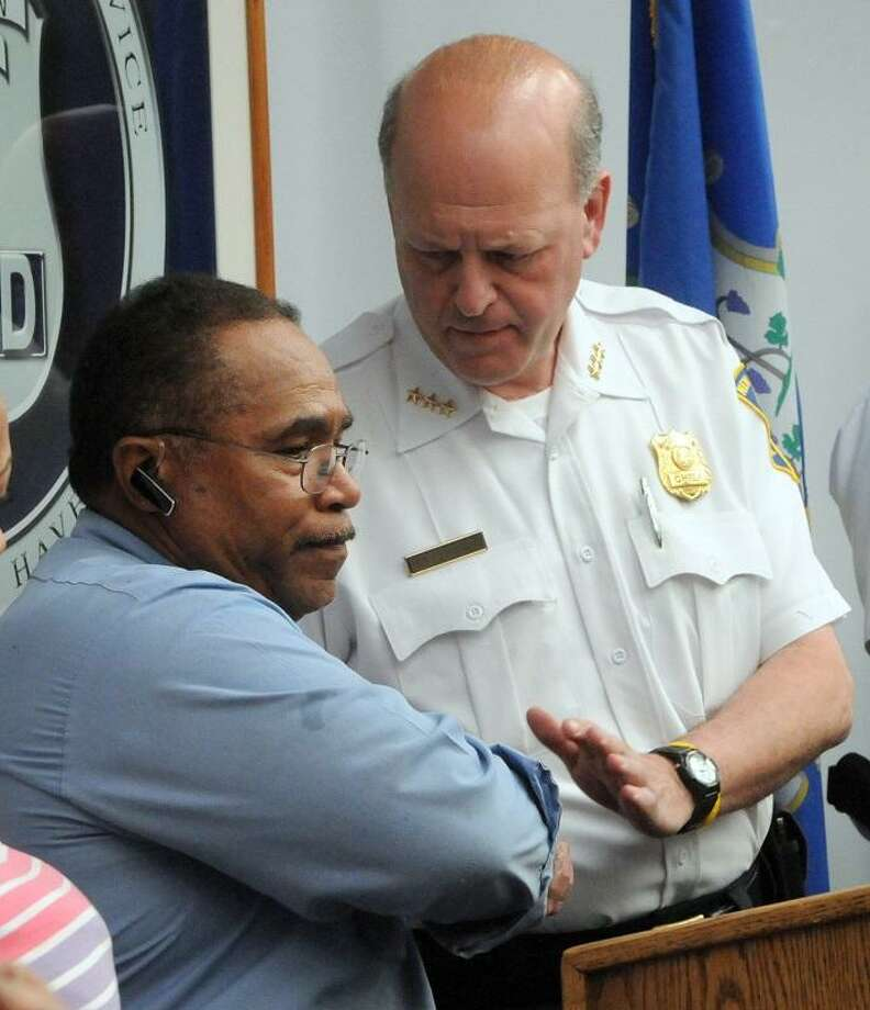 Hector Garcia, left,  father of Christian Anderson Garcia who had been murdered on October 2012, shakes the hand of New Haven Policwe hief Dean M. Esserman after Garcia thanked the New Haven Police Department Tuesday, May 7, 2013 during a press conference  at police headquarters for the arrest yesterday of Rashid Johnson who was charged with Garcia's murder.   Photo by Peter Hvizdak / New Haven Register Photo: New Haven Register / ©Peter Hvizdak /  New Haven Register