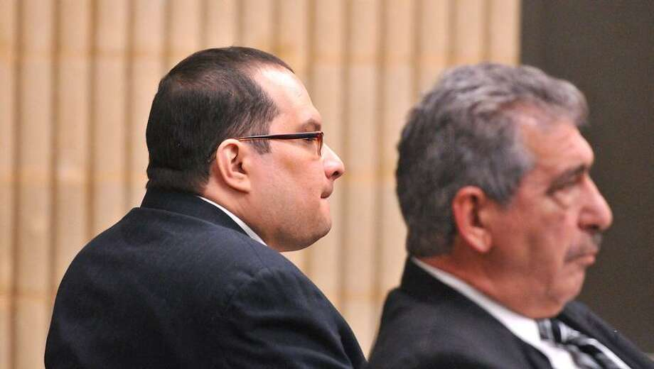 Javier Cruz-Falcon, left, along with his attorney Carmine J. Giuliano, listens as proceedings begin at his murder trial at Superior Court in Milford. Peter Casolino