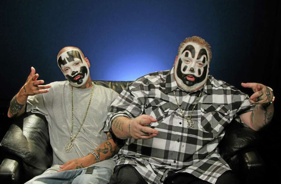This July 29, 2013 photo shows Joseph Utsler, also known as Shaggy 2 Dope, left, and  Joseph Bruce, also known as Violent J, from Insane Clown Posse,  in New York. On their  FUSE TV weekly show, the Detroit-area rappers critique all things pop culture, claiming to bring an outsiders perspective. A good part of the show has the guys critiquing music videos, much like Beavis and Butthead from a generation ago. (AP Photo/John Carucci) Photo: AP / AP