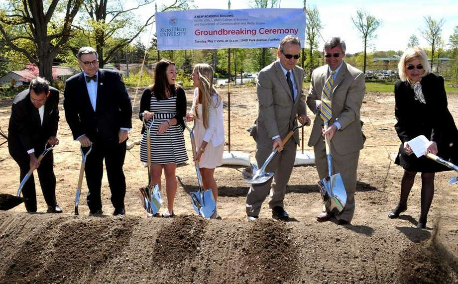 Breaking ground for Sacred Heart University's new academic building on the corner of Park Avenue and Jefferson Streets are, from left, James T. Morley, chairman of SHU's board of trustees, President John J. Petillo, outgoing Student Government President Mia James, incoming Student Government President Lauren Kalil, Welch College of Business Dean John Chalykoff, College of Arts and Sciences Dean Seamus Carey and Provost Laura Niesen de Abruna. / © Sacred Heart University 2013