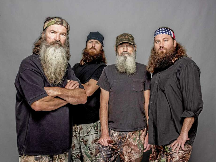 "This 2012 photo released by A&E shows, from left, Phil Robertson, Jase Robertson, Si Robertson and Willie Robertson from the A&E series, ""Duck Dynasty.""  A&E says nearly 12 million birds of a feather caught the season premiere of the hit unscripted series on Wednesday, Aug. 14, 2013.  (AP Photo/A&E, Zach Dilgard) Photo: AP / A&E"