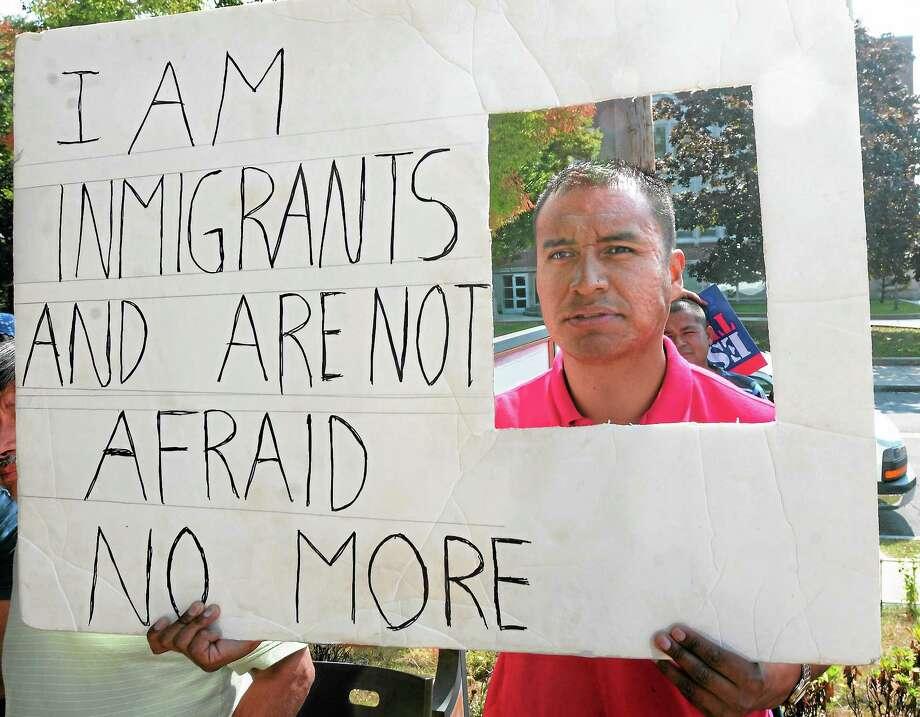 Mara Lavitt — New Haven Register Alejandro Gonzalez participates in a rally outside Junta for Progressive Action in New Haven Saturday for immigration reform. Photo: Journal Register Co. / Mara Lavitt
