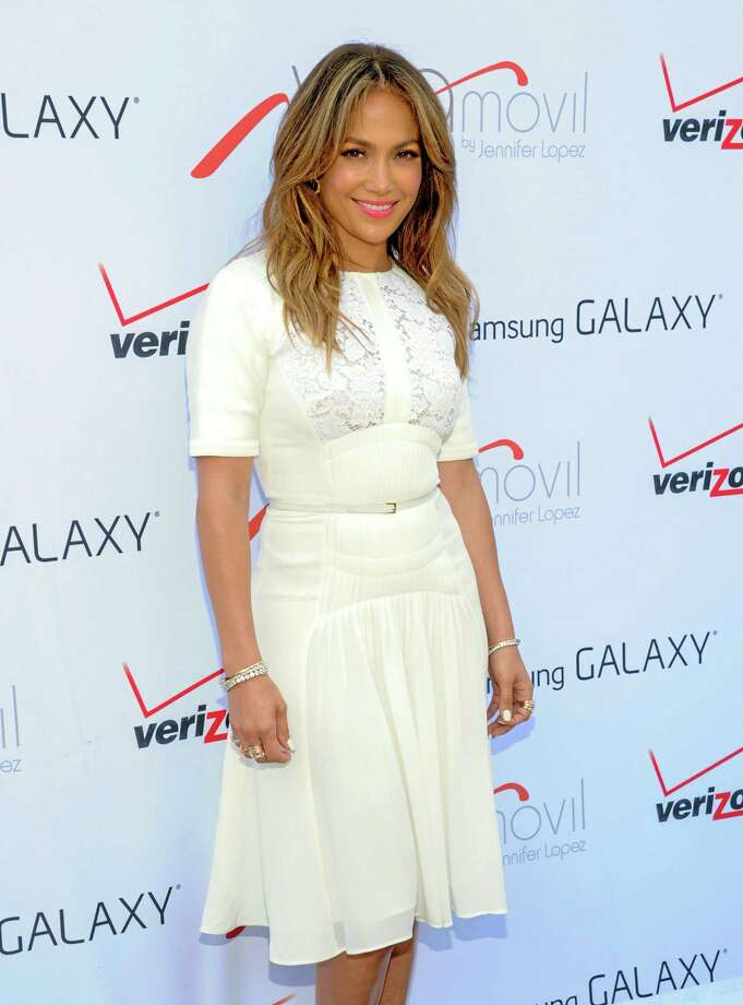 """Singer- actress Jennifer Lopez attends the """"Viva Movil by Jennifer Lopez"""" flagship store grand opening in the Brooklyn borough of New York on Friday, July 26, 2013. (Photo by Evan Agostini/Invision/AP) Photo: Evan Agostini/Invision/AP / Invision"""