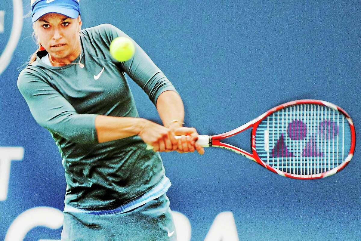 Sabine Lisicki returns a shot in her 7-5, 6-1 win over Kristina Mladenovic on Sunday.