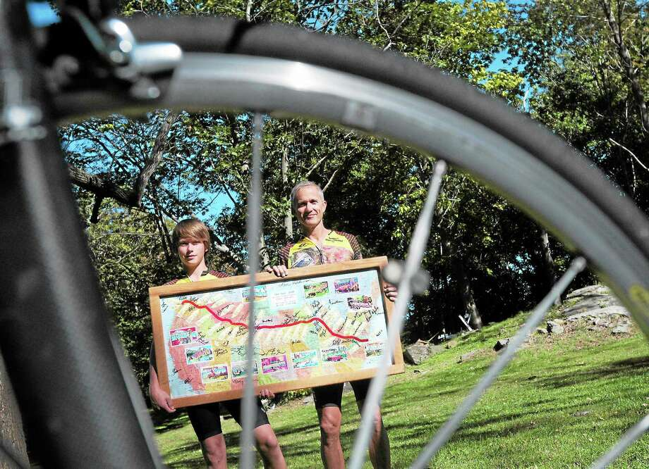 Caelan Kerin, 16, left, with his father, Mike Kerin, of Bethany showing off a map that graphed their 3,600-mile cross-country bicycle trip. Photo: Peter Hvizdak — New Haven Register   / ©Peter Hvizdak /  New Haven Register