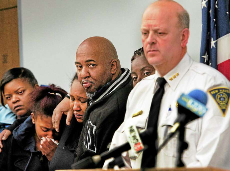 (Melanie Stengel - New Haven Register) New Haven Police Chief, Dean Esserman stands with the family of  Shamar Willet during a press conference at police Headquarters. Shunravion Jackson of Norton Street is charged with second-degree manslaughter and interfering with police, in the shooting death of Willet. Photo: Journal Register Co.