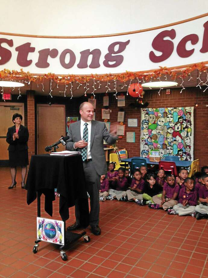 Superintendent of Schools Garth Harries speaks at a September event at New Haven's Strong School Photo: Journal Register Co.
