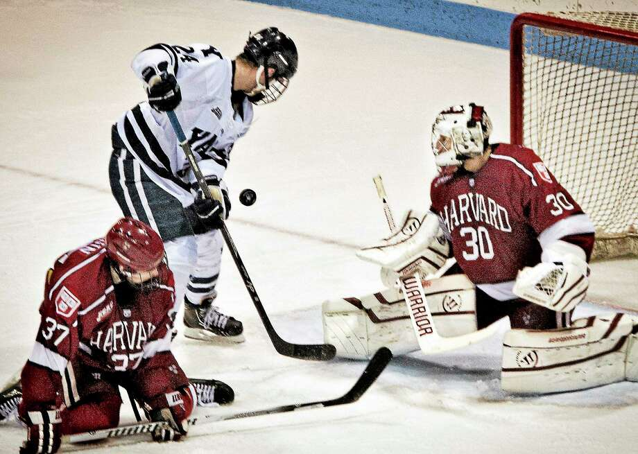 Melanie Stengel — Register  Yale's Mike Doherty tries to revcover a shot deflected by Harvard goalie Raphael Girard. Photo: Journal Register Co.