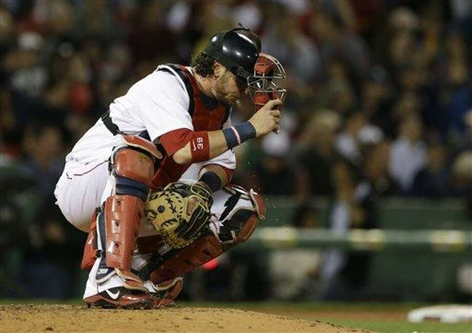 Boston Red Sox catcher Jarrod Saltalamacchia spits on the mound during a break in a baseball game against the Minnesota Twins at Fenway Park in Boston, Tuesday, May 7, 2013. (AP Photo/Elise Amendola) Photo: AP / AP