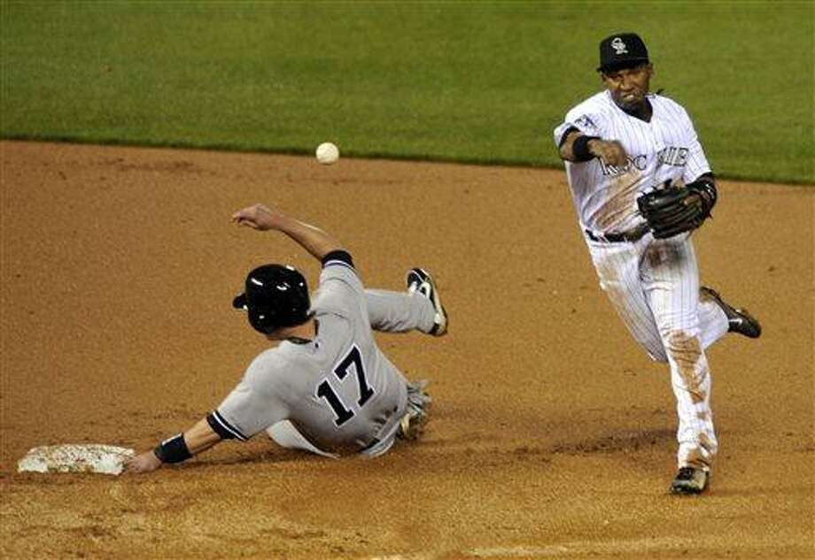 New York Yankees' Jayson Nix (17) is forced out at second by Colorado Rockies' Jonathan Herrera (18) during the ninth inning of a baseball game on Tuesday, May 7, 2013, in Denver. Colorado beat New York 2-0. (AP Photo/Jack Dempsey) Photo: AP / FR42408 AP