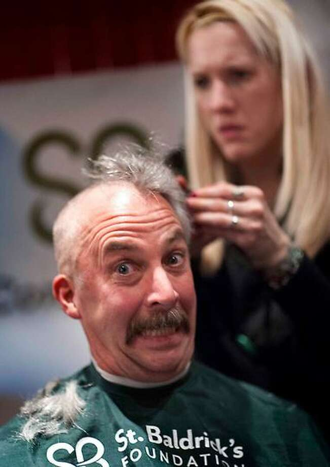 Fire departments from across the region gathered at O'Tooles on Orange St in New Haven March 1, 2013 to have their heads shaved to raise more than $35,000 at a St. Baldrick's event.  vmWilliams