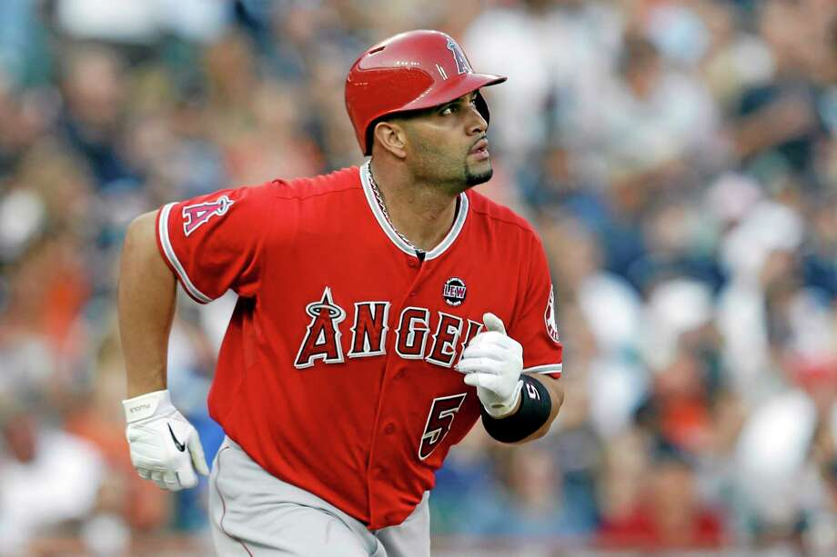 Albert Pujols sued Jack Clark on Friday over comments on a local radio show accusing the three-time NL MVP of using steroids. The lawsuit between former Cardinals stars was filed in Circuit Court in St. Louis County, where Clark lives. It seeks unspecified damages and asks for a determination and declaration that Clark's statements are false. Photo: Paul Sancya — The Associated Press   / AP
