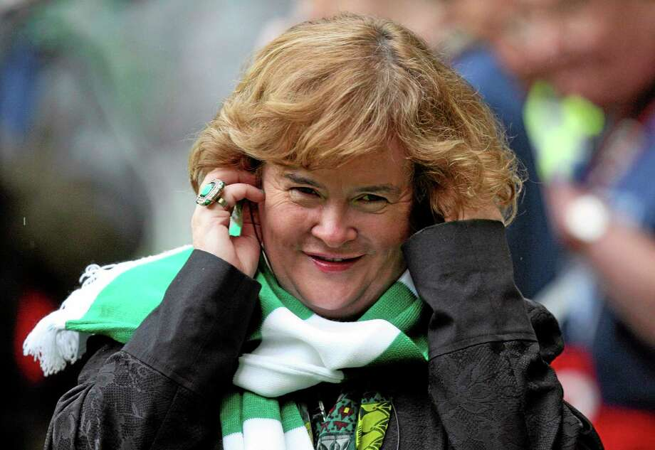 FILE - Susan Boyle performs ahead of the Champions League qualifying second round soccer match between Celtic and Helsingborgs at Celtic Park, Glasgow, Scotland, in this Aug. 29, 2012 file photo. Boyle told the Observer newspaper in an interview published Sunday Dec. 8, 2013, she has been diagnosed with Asperger's syndrome, a form of autism, after seeing a specialist a year ago. (AP Photo/Scott Heppell, File) Photo: AP / AP