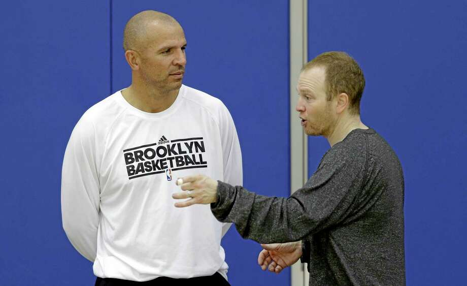 Brooklyn Nets coach Jason Kidd, left, and assistant coach Lawrence Frank talk Wednesday during training camp at Duke University in Durham, N.C. Kidd has been suspended for two games for pleading guilty to driving while ability impaired, the NBA announced on Friday. He will miss the first two games of the regular season starting on Oct. 29. Photo: Gerry Broome — The Associated Press   / AP
