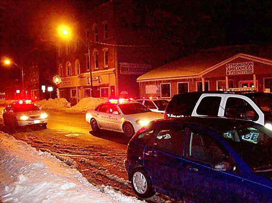 Photo Special to the Dispatch by MIKE JAQUAYS Oneida City Police respond to a fight on Madison Street on Jan. 1, 2013, in Oneida.
