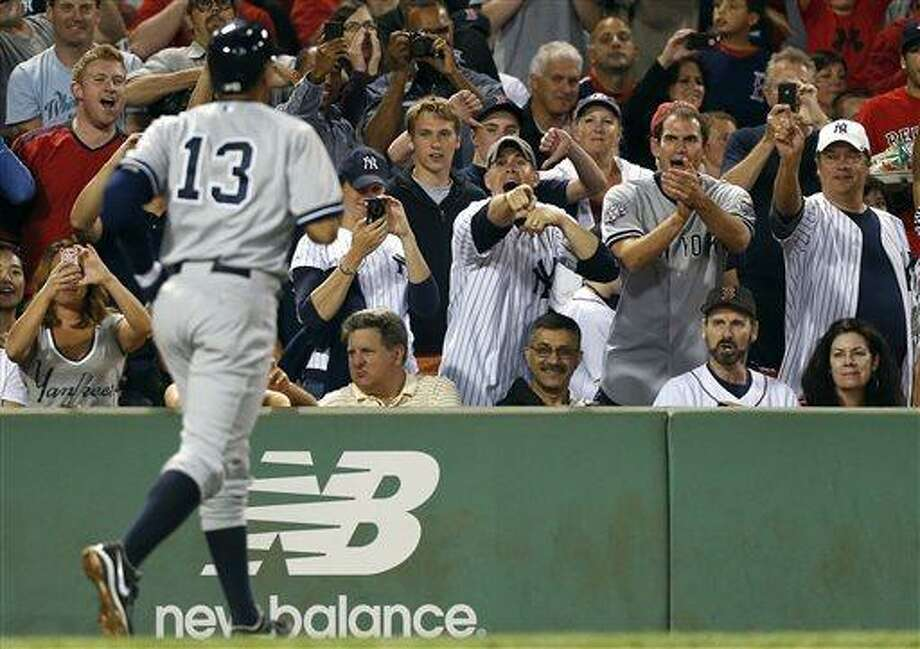 Fans react as New York Yankees' Alex Rodriguez (13) heads to the dug out after hitting a solo home run in the sixth inning of a baseball game against the Boston Red Sox, Sunday, Aug. 18, 2013, in Boston. (AP Photo/Michael Dwyer) Photo: AP / AP