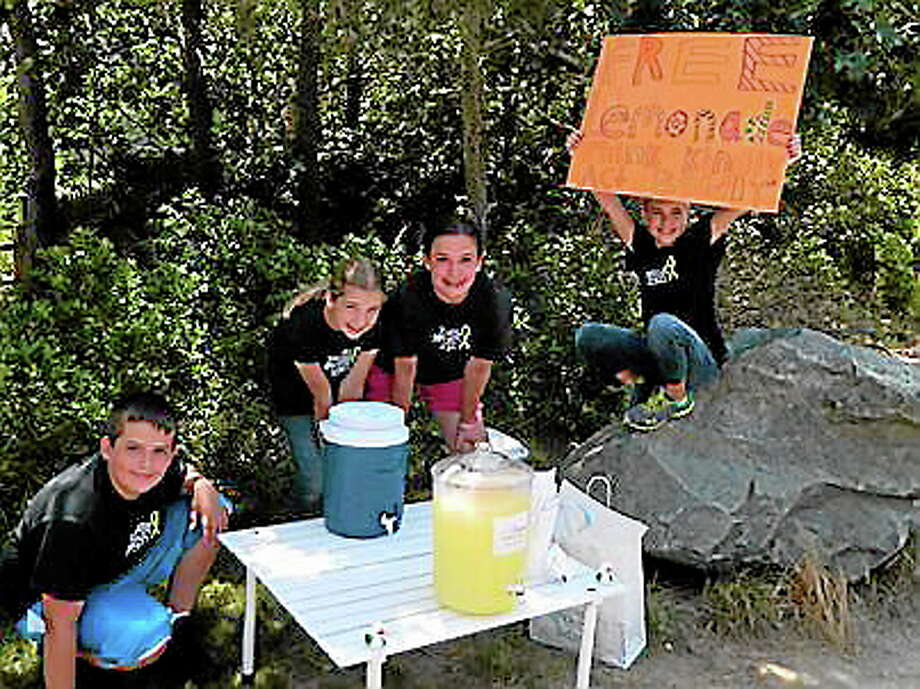 Newtown Kindness provided children with lemons, sugar and jugs so they could give away lemonade in their neighborhoods. (Contributed photo from Newtown Kindness) Photo: Journal Register Co.