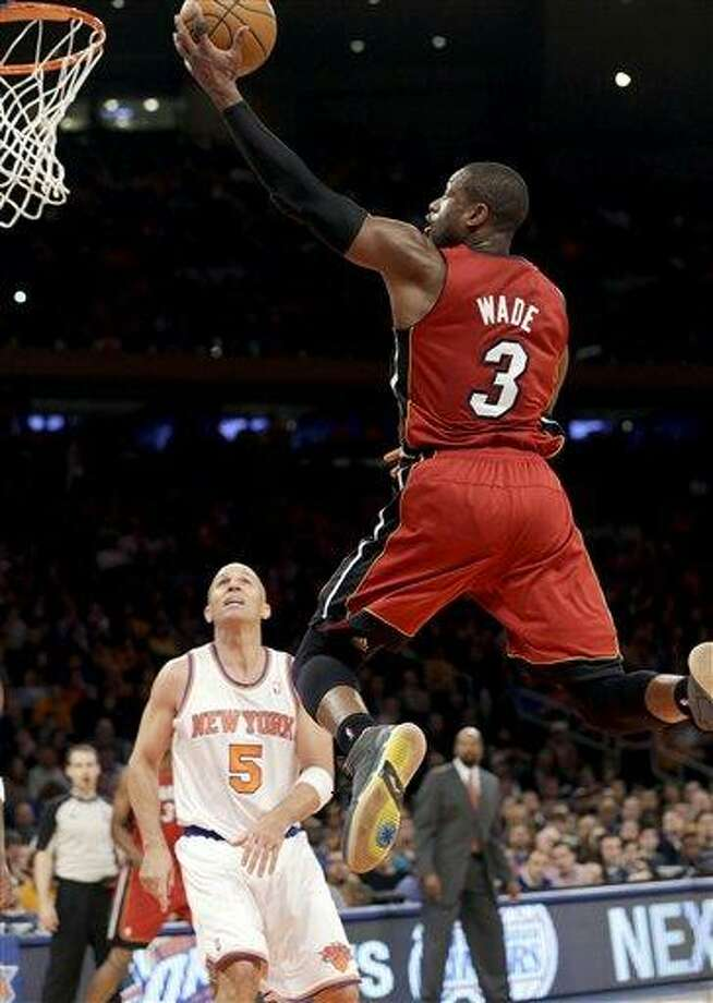 Miami Heat guard Dwyane Wade (3) shoots a layup in front of New York Knicks guard Jason Kidd (5) during the second half of their NBA basketball game at Madison Square Garden in New York, Sunday, March 3, 2013. Wade scored 20 points as the Heat won 99-93. (AP Photo/Kathy Willens) Photo: ASSOCIATED PRESS / AP2013