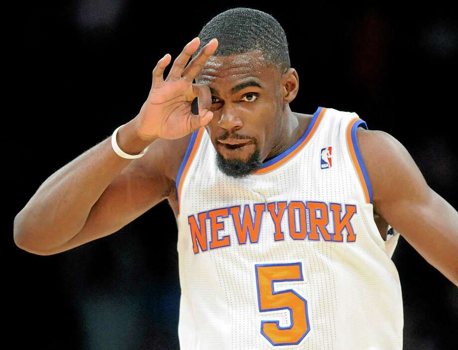 The Knicks' Timothy Hardaway Jr. reacts after hitting a 3-pointer during the fourth quarter of Friday night's game against the Orlando Magic in New York. The Knicks won 121-83. Photo: Bill Kostroun — The Associated Press   / FR51951 AP