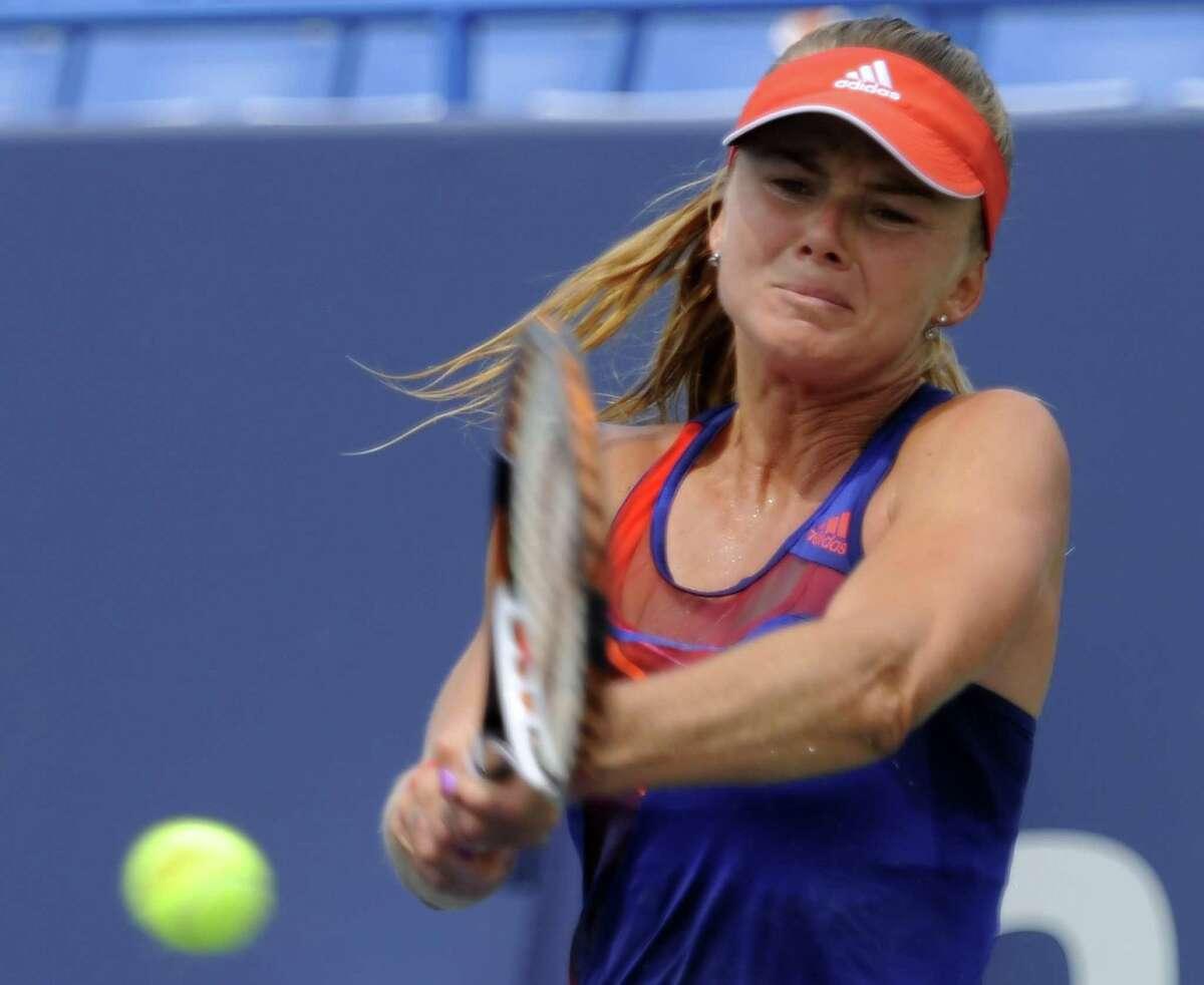 Daniela Hantuchova hits a backhand return to Simona Halep at the New Haven Open Monday., Aug. 18, 2013 (Bob Child Photo)
