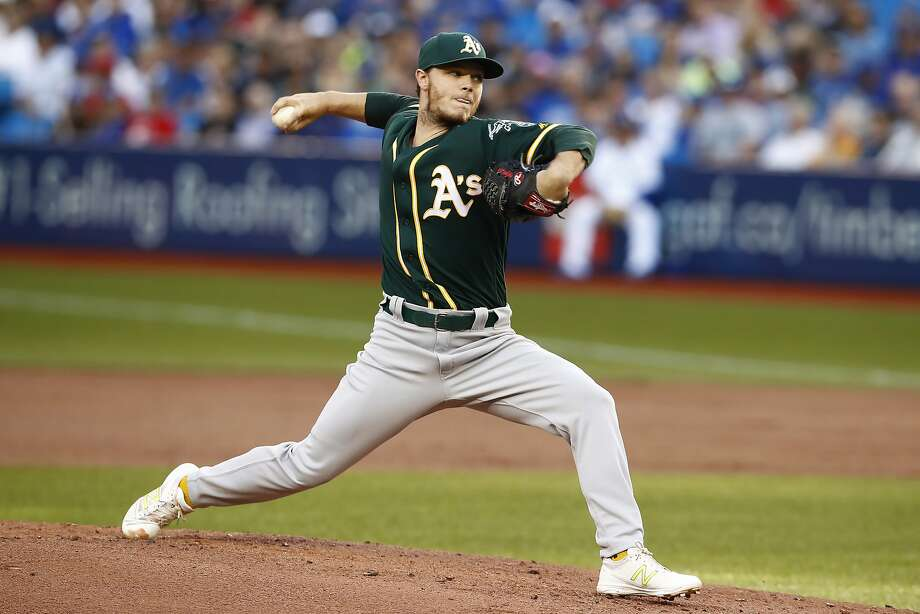 Oakland Athletics starting pitcher Sonny Gray throws to a Toronto Blue Jays batter during the first inning of a baseball game Tuesday, July 25, 2017, in Toronto. (Mark Blinch/The Canadian Press via AP) Photo: Mark Blinch, Associated Press
