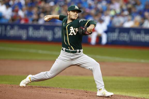 Oakland Athletics starting pitcher Sonny Gray throws to a Toronto Blue Jays batter during the first inning of a baseball game Tuesday, July 25, 2017, in Toronto. (Mark Blinch/The Canadian Press via AP)