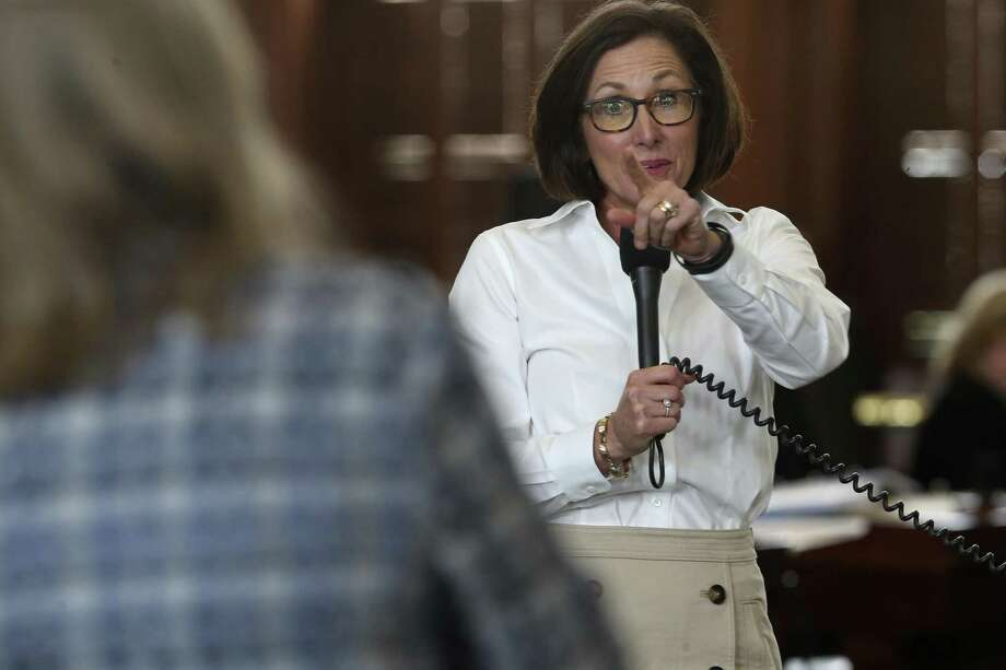 State Sen. Lois Kolkhorst, R-Brenham, reacts to a basketball game challenge from Sen. Sylvia Garcia, D-Houston, during a review of Kolkhorst's bathroom bill in the Capitol. Photo: JERRY LARA / San Antonio Express-News / San Antonio Express-News
