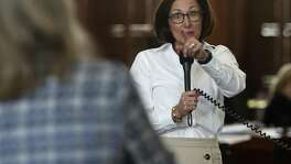 State Sen. Lois Kolkhorst, R-Brenham, reacts to a basketball game challenge from Sen. Sylvia Garcia, D-Houston, during a review of Kolkhorst's bathroom bill in the Capitol.