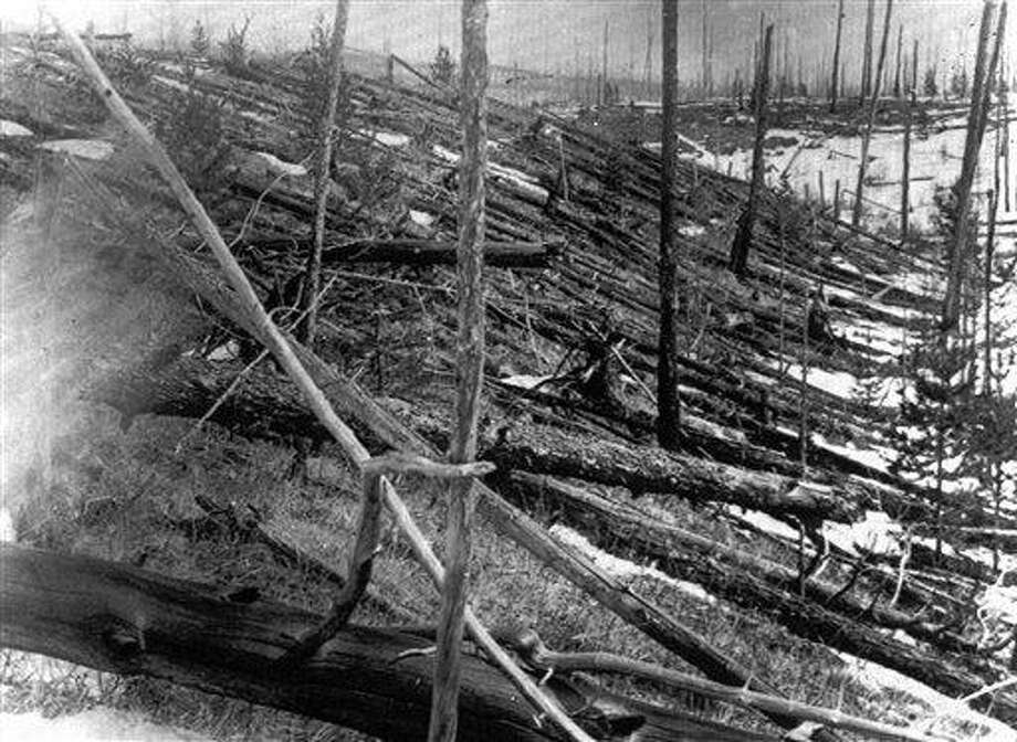 FILE - In this 1953 file photo, trees lie strewn across the Siberian countryside 45 years after a meteorite struck the Earth near Tunguska, Russia. The 1908 explosion is generally estimated to have been about 10 megatons; it leveled some 80 million trees for miles near the impact site. The meteor that streaked across the Russian sky Friday, Feb. 15, 2013, is estimated to be about 10 tons. It exploded with the power of an atomic bomb over the Ural Mountains, about 5,000 kilometers (3,000 miles) west of Tunguska. (AP Photo, File) Photo: AP / AP