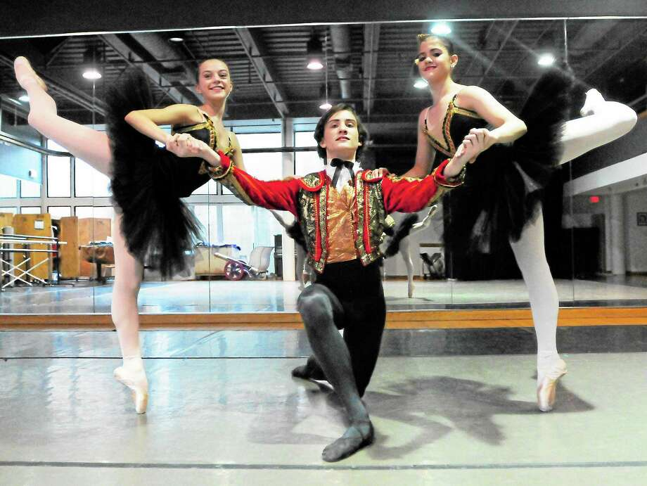 "New Haven Nutcracker Ballet lead dancers Teraesa Vitelli of Woodbridge, 16, left, Damiano Scarfi, 15, and his sister Olivia Scarfi, 14, both of Middletown, pose during a  ""Nutcracker"" scene rehearsal as Spanish Hot Chocolates at the New Haven Ballet's dance studio in New Haven. Photo: Peter Hvizdak — New Haven Register Photos   / ©Peter Hvizdak /  New Haven Register"