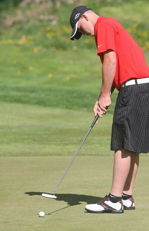PHOTO BY JOHN HAEGER @ ONEIDAPHOTO ON TWITTER/ONEIDA DAILY DISPATCH VVS' Jon Fewer watches his putt on one during a match against Oneida on Tuesday, May 7, 2013 in Oneida.