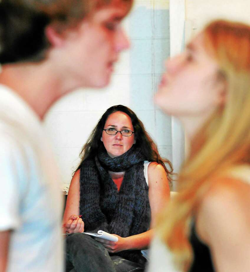 """Mara Lavitt — Register   Long Wharf Theatre's Shake-It-Up Shakespeare's """"Romeo and Juliet"""" rehearsals continue with Jeremiah Taubl of New Haven as Romeo and Dawn Williams of Trumbull as Juliet. LWT's Director of Education Annie DiMartino, center, directs the show. Photo: Journal Register Co."""
